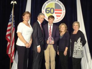Justin Fritscher (center) receives the Young Professional Award with KRB Treasurer Leigh Anne Leech, Keep America Beautiful CEO and President Matt McKenna, KRB Executive Director Jeannine May and Keep Mississippi Beautiful Executive Director Sarah Kountouris.